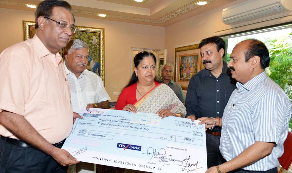 cm presents cheque 101000