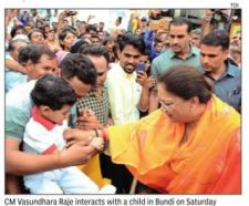 CM Vasundhara Raje interacts with a child in Bundi