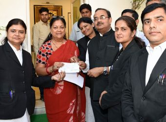 cm receives cheque kerala flood relief